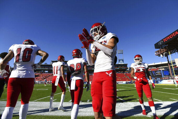 Eastern Washington wide receiver Andrew Boston gets pumped up before the FCS championship NCAA college football game against North Dakota State, Saturday, Jan. 5, 2019, in Frisco, Texas. (AP Photo/Jeffrey McWhorter)