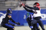 BYU linebacker Kavika Fonua, back right, breaks up a pass to San Diego State wide receiver Elijah Kothe (96) as BYU linebacker Jackson Kaufusi (38) watches during the first half of an NCAA college football game against San Diego State Saturday, Dec. 12, 2020, in Provo, Utah. (AP Photo/George Frey, Pool)