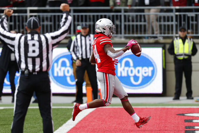 Ohio State receiver K.J. Hill scores a touchdown against Minnesota during the first half of an NCAA college football game Saturday, Oct. 13, 2018, in Columbus, Ohio. (AP Photo/Jay LaPrete)