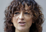French microbiologist Emmanuelle Charpentier talks to media people in Berlin, Germany, Wednesday, Oct. 7, 2020. French scientist Emmanuelle Charpentier and American Jennifer A. Doudna have won the Nobel Prize 2020 in chemistry for developing a method of genome editing likened to 'molecular scissors' that offer the promise of one day curing genetic diseases. (AP Photo/Markus Schreiber)