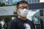 """Pro-democracy activist Raphael Wong arrives at a local court in Hong Kong Thursday, Aug. 19, 2021. A trial opens for seven prominent Hong Kong pro-democracy activists including Wong, in connection with an anti-government protest on Aug. 20, 2019. They are charged with """"incitement to knowingly take part in an unauthorized assembly."""" The trial is expected to last about a week. (AP Photo/Vincent Yu)"""
