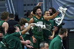 Ohio's Mark Sears (10) and teammates cheer during the first half of an NCAA college basketball game against Buffalo for the championship of the Mid-American Conference men's tournament Saturday, March 13, 2021, in Cleveland. (AP Photo/Tony Dejak)