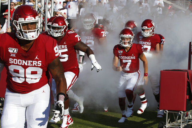 FILE - Oklahoma quarterback Spencer Rattler (7) runs onto the field before an NCAA college football game against South Dakota Saturday, Sept. 7, 2019, in Norman, Okla. Rattler, a redshirt freshman, has been named Oklahoma's starting quarterback. Missouri State plays at No. 5 Oklahoma on Saturday, Sept. 12, 2020. (AP Photo/Sue Ogrocki, File)