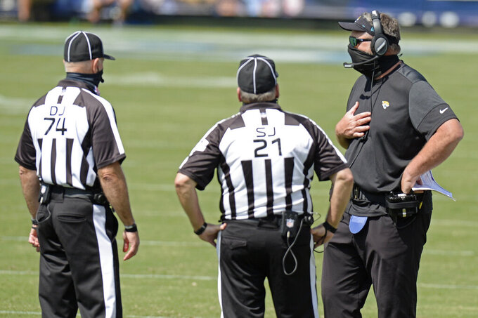 Jacksonville Jaguars head coach Doug Marrone talks with officials in the first half of an NFL football game against the Tennessee Titans Sunday, Sept. 20, 2020, in Nashville, Tenn. (AP Photo/Mark Zaleski)