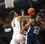 Minnesota guard Amir Coffey (5) battles for the rebound against Penn State guard Josh Reaves (23) during the first half of an NCAA basketball game Saturday, Jan. 19, 2019, in Minneapolis. (AP Photo/Paul Battaglia)