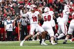 Miami (Ohio) quarterback AJ Mayer (10) throws during the first half of an NCAA college football game against Cincinnati, Saturday, Sept. 4, 2021, in Cincinnati. (AP Photo/Jeff Dean)