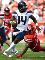 Arizona quarterback Khalil Tate (14) escapes the tackle of Houston defensive tackle Ed Oliver during the first half of an NCAA college football game, Saturday, Sept. 8, 2018, in Houston. (AP Photo/Eric Christian Smith)
