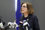 FILE - In this March 16, 2020, file photo, Oregon Gov. Kate Brown speaks at a news conference in Portland, Ore. A county judge has declared Brown's coronavirus restrictions