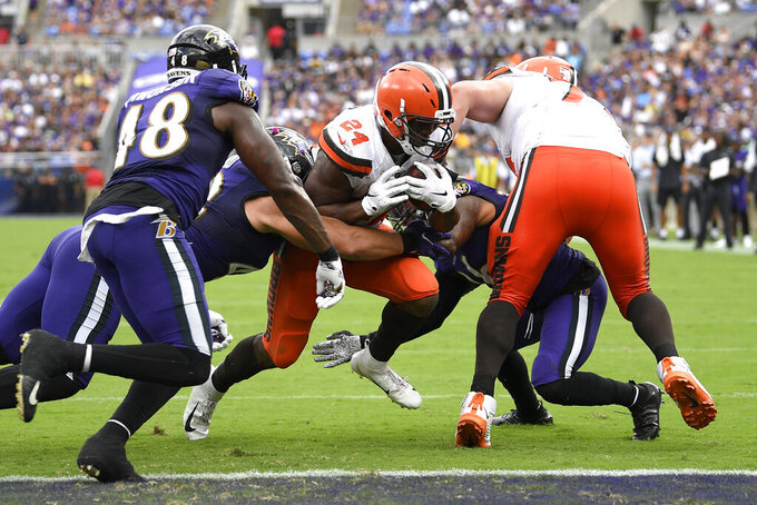 Cleveland Browns running back Nick Chubb (24) pushes through to score a touchdown run against the Baltimore Ravens during the second half of an NFL football game Sunday, Sept. 29, 2019, in Baltimore. (AP Photo/Nick Wass)