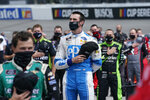 CORRECTS DATE TO SEPT. 12-Austin Cindric (22) puts his hat to his heart during the National anthem prior to the start of a NASCAR Xfinity Series auto race Saturday, Sept. 1, 2020, in Richmond, Va. (AP Photo/Steve Helber)