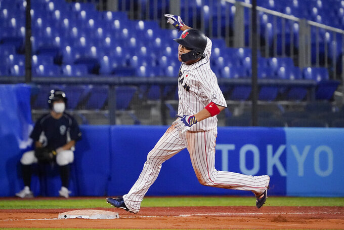 Japan's Tetsuto Yamada advances to third after stealing second during the ninth inning of a baseball game against the United States at the 2020 Summer Olympics, Monday, Aug. 2, 2021, in Yokohama, Japan. (AP Photo/Sue Ogrocki)