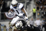Connecticut's Art Thompkins (1) hurdles Central Florida's Zamari Maxwell (8) while returning a kickoff during the first half of an NCAA college football game Saturday, Sept. 28, 2019, in Orlando, Fla. (AP Photo/Phelan M. Ebenhack)
