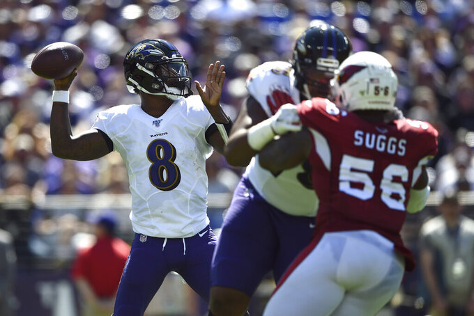 Baltimore Ravens quarterback Lamar Jackson (8) throws to a receiver as he is pressured by Arizona Cardinals outside linebacker Terrell Suggs (56) in the first half of an NFL football game, Sunday, Sept. 15, 2019, in Baltimore. (AP Photo/Gail Burton)
