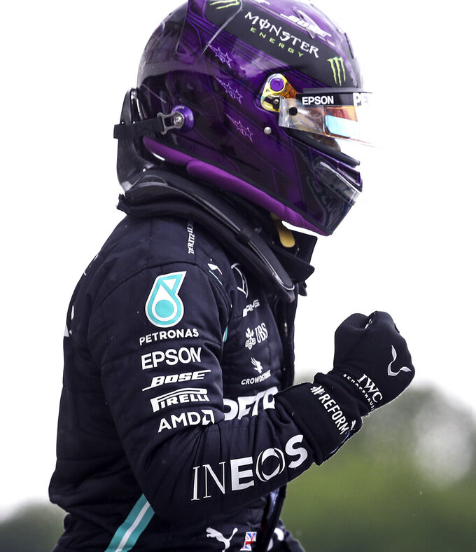 Mercedes driver Lewis Hamilton of Britain reacts after winning the qualifying for the Hungarian Formula One Grand Prix at the Hungaroring racetrack in Mogyorod, Hungary, Saturday, July 18, 2020. The Hungarian F1 Grand Prix will be held on Sunday. (Mark Thompson/Pool via AP)