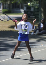 Addison Coleman, 7, of Wilmington, steps into a return during the Tennis Rocks Tutoring and Music Association's last day of its summer session for young people at  Haynes Park, Thursday, Aug. 5, 2021, in Wilmington, Del. (William Bretzger/The News Journal via AP)
