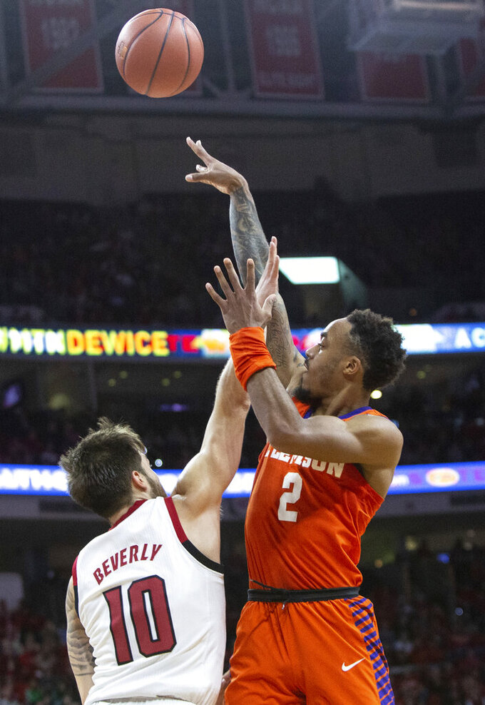 Clemson's Marcquise Reed (2) attempts a shot over North Carolina State's Braxton Beverly (10) during the second half of an NCAA college basketball game in Raleigh, N.C., Saturday, Jan. 26, 2019. (AP Photo/Ben McKeown)