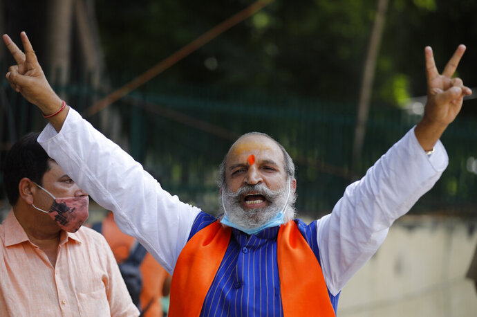 Jai Bhagwan Goyal, a leader of India's ruling Bharatiya Janata Party and an accused in the 1992 attack and demolition of a 16th century mosque, celebrates outside a court in Lucknow, India, Wednesday, Sept. 30, 2020. An Indian court on Wednesday acquitted all 32 accused, including senior leaders of the ruling Hindu nationalist Bharatiya Janata Party, in the case. The demolition sparked Hindu-Muslim violence that left some 2,000 people dead. (AP Photo/Rajesh Kumar Singh)