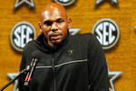 FILE - In this Wednesday, Oct. 16, 2019, file photo, Vanderbilt head coach Jerry Stackhouse speaks during the Southeastern Conference NCAA college basketball media day in Birmingham, Ala. Juwan Howard took over his former team when he replaced John Beilein at Michigan, and Stackhouse was hired to be the new coach at Vanderbilt. Both of them starred as players in the early-to-mid 1990s and went on to lengthy NBA careers. (AP Photo/Butch Dill, File)