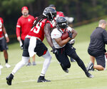 Atlanta Falcons running back Devonta Freeman (24) tries to break free from linebacker De'Vondre Campbell (59) during NFL football minicamp Wednesday, June 13, 2018 in Flowery Branch, Ga. (AP Photo/John Bazemore)