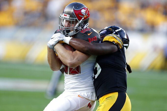 Pittsburgh Steelers linebacker Devin Bush, right, tackles Tampa Bay Buccaneers tight end Tanner Hudson during the first half of an NFL preseason football game in Pittsburgh, Friday, Aug. 9, 2019. (AP Photo/Keith Srakocic)