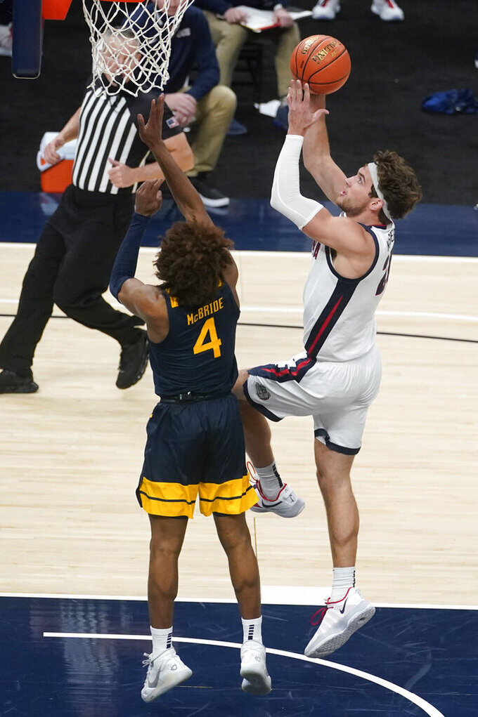 Gonzaga's Corey Kispert (24) shoots against West Virginia's Miles McBride (4) during the second half of an NCAA college basketball game Wednesday, Dec. 2, 2020, in Indianapolis. (AP Photo/Darron Cummings)