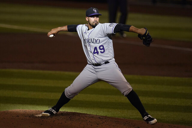 Colorado Rockies starting pitcher Antonio Senzatela throws a pitch to an Arizona Diamondbacks batter during the first inning during the first game of a baseball doubleheader Friday, Sept. 25, 2020, in Phoenix. (AP Photo/Ross D. Franklin)