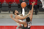 Houston forward Reggie Chaney, left, shoots as Western Kentucky center Charles Bassey defends during the first half of an NCAA college basketball game, Thursday, Feb. 25, 2021, in Houston. (AP Photo/Eric Christian Smith)