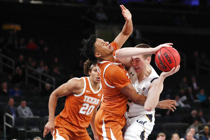 Texas forward Gerald Liddell (0) collides while defending California forward Grant Anticevich, right, as Texas forward Jericho Sims (20) watches during the first half of an NCAA college basketball game in the 2K Empire Classic, Friday, Nov. 22, 2019, in New York. (AP Photo/Kathy Willens)