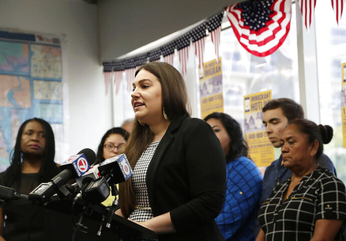Alana Greer, of the Community Justice Project, speaks during a news conference announcing that a coalition of immigrant rights groups are filing a federal lawsuit over Senate Bill 168, a new Florida state law requiring local law enforcement officials to cooperate with federal immigration authorities, Tuesday, July 16, 2019, in Miami. (AP Photo/Lynne Sladky)