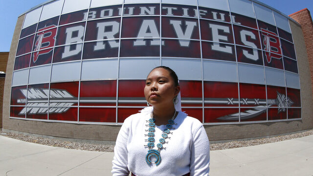 FILE - In this July 21, 2020, file photo, Lemiley Lane, a Bountiful junior who grew up in the Navajo Nation in Arizona, poses for a photograph at Bountiful High School in Bountiful, Utah. A mostly white high school near Salt Lake City will begin the process to replace its hotly-contested Braves mascot after nearly 70 years. Bountiful High School Principal Aaron Hogge said Monday, Nov. 30, 2020, the school will start the process to select a