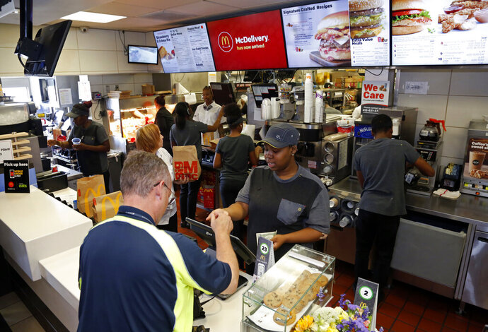 FILE - In this July 18, 2018, file photo a customer gets his coffee at a McDonald's restaurant in Pittsburgh. In a very limited test in Canada, McDonald's said Thursday, Sept. 26, 2019, that it's introducing the PLT, or the plant, lettuce and tomato burger. It will be available for 12 weeks in 28 restaurants in Southwestern Ontario by the end of the month. (AP Photo/Gene Puskar, File)