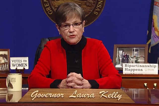 This computer screen capture from Kansas Gov. Laura Kelly's page on Facebook shows her giving the annual State of the State address, Tuesday, Kan., Tuesday, Jan. 12, 2021, in Topeka, Kan. Kelly says that given the recent mob violence in Washington, the state's leaders must
