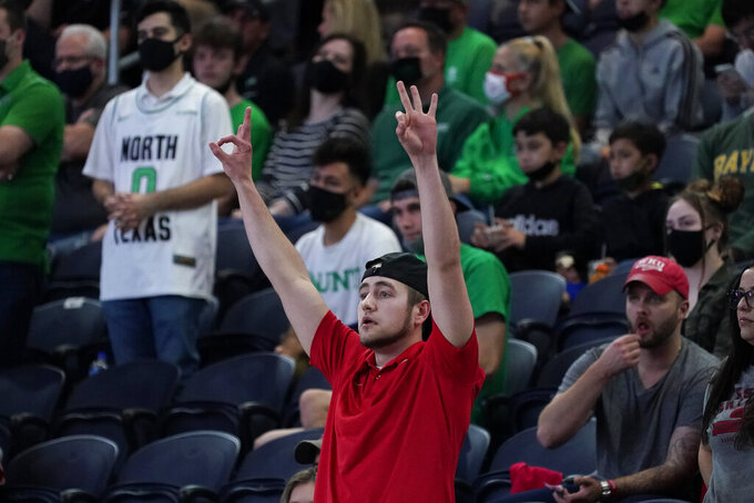 A Western Kentucky fan reacts during the second half of the championship game between North Texas and Western Kentucky in the NCAA Conference USA men's basketball tournament Saturday, March 13, 2021, in Frisco, Texas. (AP Photo/Tony Gutierrez)