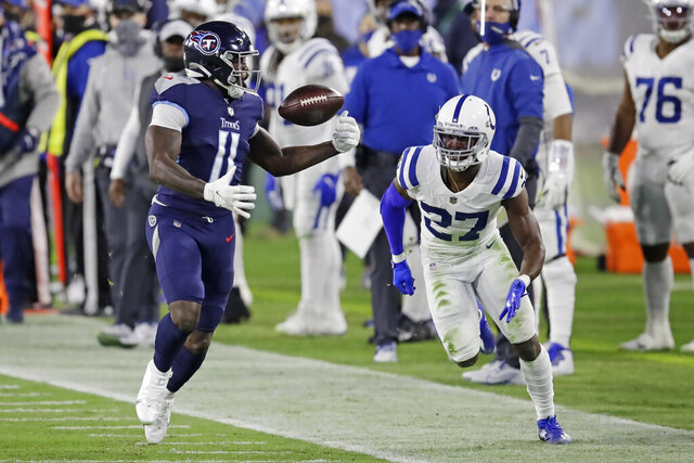 Tennessee Titans wide receiver A.J. Brown (11) juggles the ball before dropping it as he is defended by Indianapolis Colts cornerback Xavier Rhodes (27) in the first half of an NFL football game Thursday, Nov. 12, 2020, in Nashville, Tenn. (AP Photo/Ben Margot)