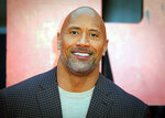 FILE - In this April 11, 2018, file photo, actor Dwayne Johnson poses for photographers at the premiere of the