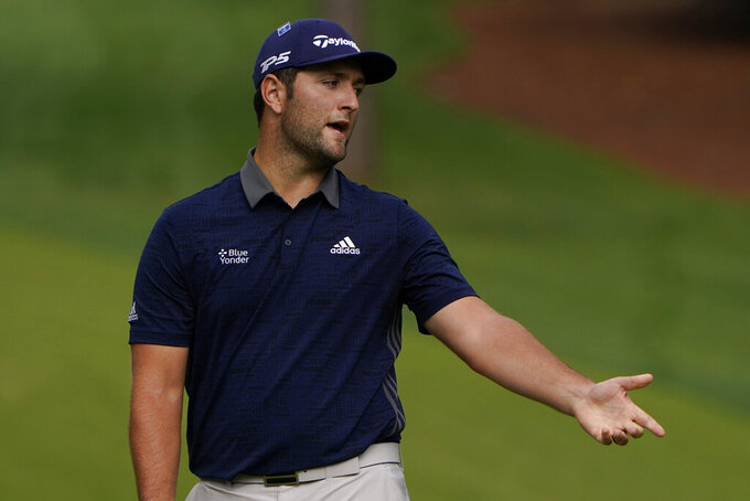 Jon Rahm, of Spain, reacts to his missed putt on the 10th green during the final round of the Masters golf tournament Sunday, Nov. 15, 2020, in Augusta, Ga. (AP Photo/Chris Carlson)