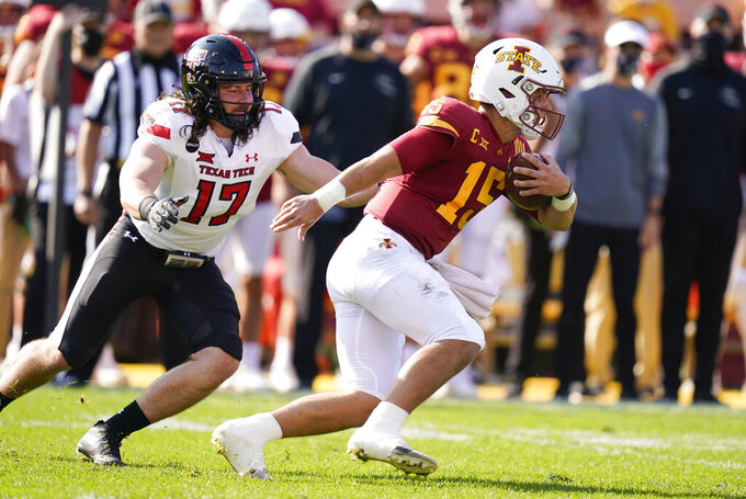 Iowa State quarterback Brock Purdy (15) runs from Texas Tech linebacker Colin Schooler (17) during the first half of an NCAA college football game, Saturday, Oct. 10, 2020, in Ames, Iowa. (AP Photo/Charlie Neibergall)