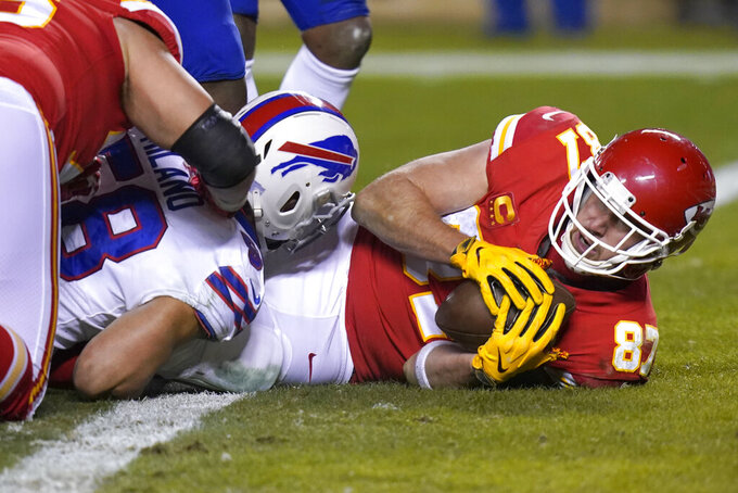 Kansas City Chiefs tight end Travis Kelce (87) scores on a 1-yard touchdown reception during the second half of the AFC championship NFL football game against the Buffalo Bills, Sunday, Jan. 24, 2021, in Kansas City, Mo. (AP Photo/Orlin Wagner)