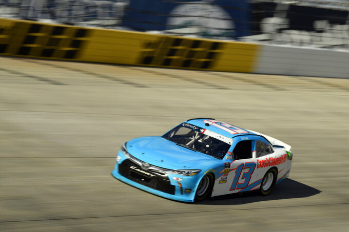 Driver Carl Long (#13) comes out of turn one during stage one of the NASCAR Xfinity Series auto race, Saturday, Oct. 5, 2019, in Dover, Del. (AP Photo/Brien Aho)
