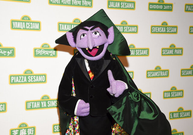 FILE - This May 30, 2018 file photo shows Sesame Street character Count von Count at Sesame Workshop's 16th annual Benefit Gala in New York. The Muppet best known as the Count is joining Elmo, Rosita and her mom, Rosa, in public service announcements airing Monday, March 9, 2020, to encourage parents of young children to make sure they and their children are counted in the 2020 census.  (Photo by Evan Agostini/Invision/AP, File)