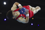 Gold medalist Carlos Edriel Yulo of the Philippines performs in the floor exercise in the men's apparatus finals at the Gymnastics World Championships in Stuttgart, Germany, Saturday, Oct. 12, 2019. (AP Photo/Matthias Schrader)