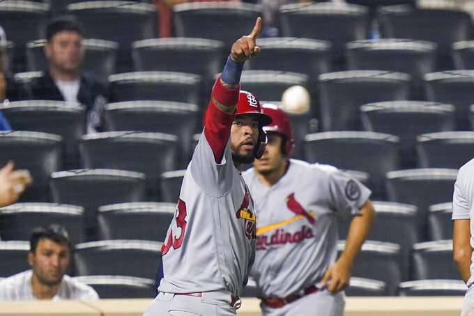 St. Louis Cardinals' Edmundo Sosa (63) gestures to Andrew Knizner at first base after scoring on a two-run single by Knizner during the 11th inning of the team's baseball game against the New York Mets on Tuesday, Sept. 14, 2021, in New York. (AP Photo/Frank Franklin II)