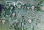 This 1982 photo courtesy of Diego Carlos Arreseigor shows him, standing center, with his battalion during the Falklands War where Argentina and Britain battled over the archipelago which Argentina calls Las Malvinas. Arreseigor found and kept the helmet of British soldier Alexander Shaw as a trophy of war. Thirty-seven years later, in 2019, he was able to contact the soldier's sister in order to arrange its return this year.