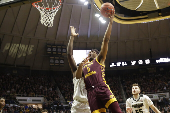 Central Michigan forward Rob Montgomery (5) goes up for a layup during the first half of an NCAA college basketball game in West Lafayette, Ind., Saturday, Dec. 28, 2019. (Nikos Frazier/Journal & Courier via AP)