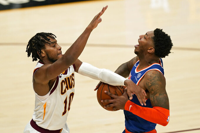 Cleveland Cavaliers' Darius Garland (10) fouls New York Knicks' Elfrid Payton during the second half of an NBA basketball game, Tuesday, Dec. 29, 2020, in Cleveland. The Knicks won 95-86. (AP Photo/Tony Dejak)
