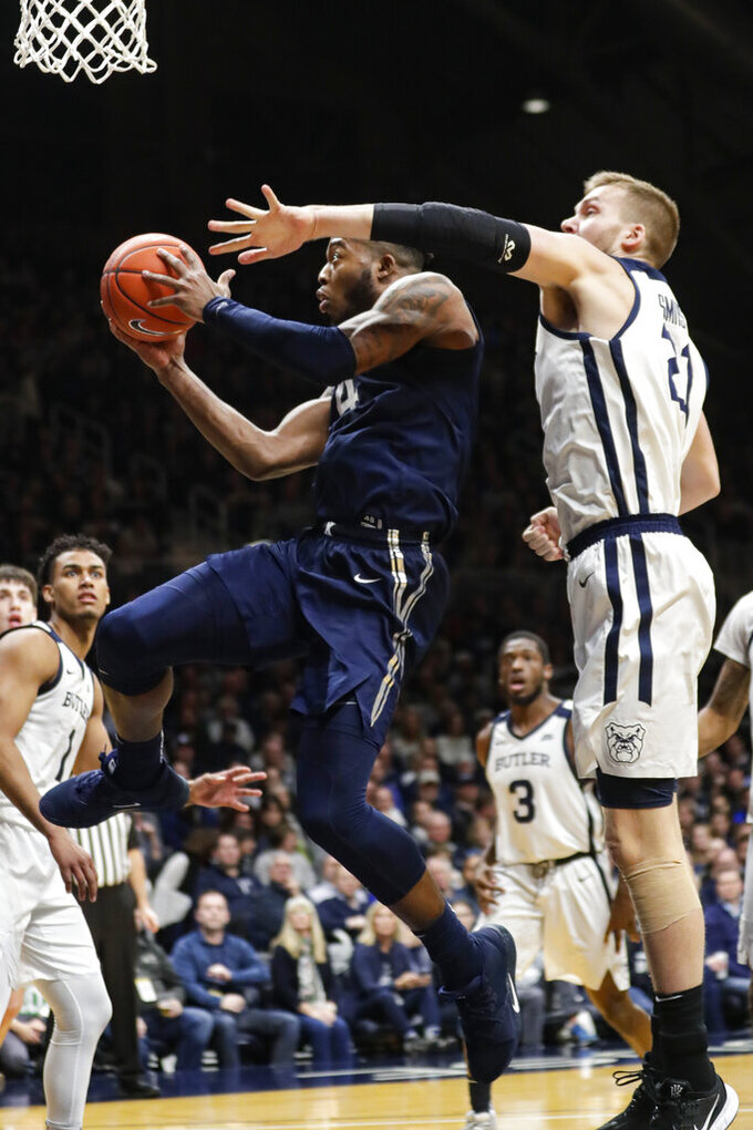 Xavier forward Tyrique Jones (4) shoots under Butler forward Sean McDermott (22) in the second half of an NCAA college basketball game in Indianapolis, Wednesday, Feb. 12, 2020. Butler defeated Xavier 66-61. (AP Photo/Michael Conroy)