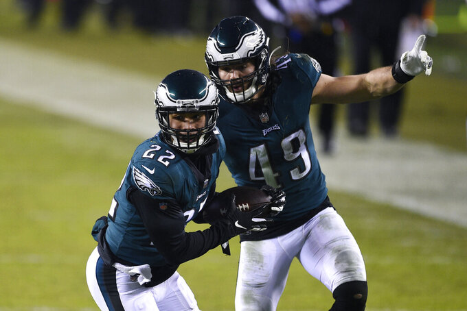 Philadelphia Eagles' Marcus Epps (22) celebrates with Alex Singleton (49) after intercepting a pass during the second half of an NFL football game against the Washington Football Team, Sunday, Jan. 3, 2021, in Philadelphia. (AP Photo/Derik Hamilton)