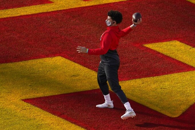 Kansas City Chiefs quarterback Patrick Mahomes throws as he warms up before the NFL Super Bowl 55 football game between the Kansas City Chiefs and Tampa Bay Buccaneers, Sunday, Feb. 7, 2021, in Tampa, Fla. (AP Photo/Charlie Riedel)