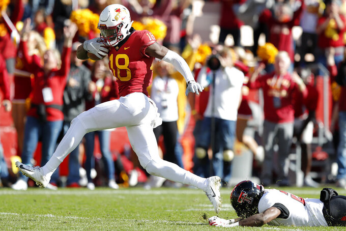 Iowa State wide receiver Hakeem Butler (18) runs from Texas Tech defensive back Damarcus Fields during a 48-yard touchdown reception in the second half of an NCAA college football game, Saturday, Oct. 27, 2018, in Ames, Iowa. Iowa State won 40-31. (AP Photo/Charlie Neibergall)