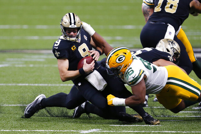 New Orleans Saints quarterback Drew Brees (9) is sacked by Green Bay Packers defensive end Kingsley Keke (96) in the first half of an NFL football game in New Orleans, Sunday, Sept. 27, 2020. (AP Photo/Brett Duke)